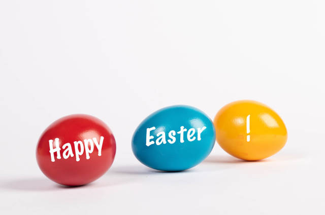 Happy easter text written on Easter eggs