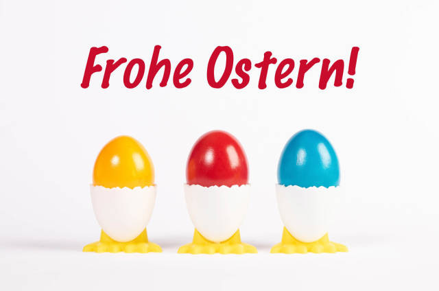 Frohe Ostern text with painted Easter eggs