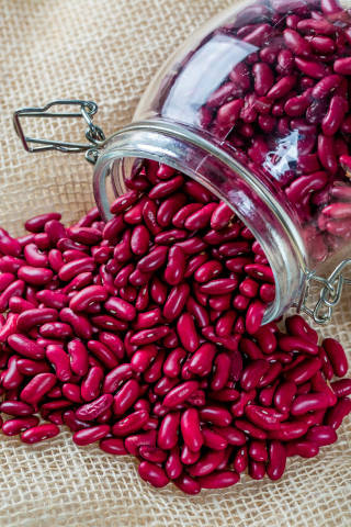 Red beans poured from a glass jar