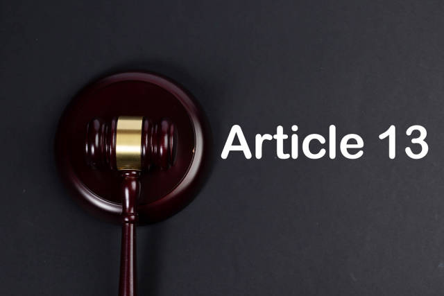 Wooden gavel with Article 13 text