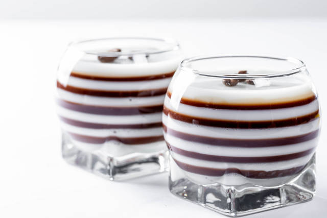 Sweet dessert with many layers of white and brown jelly
