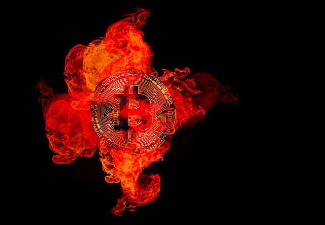 Bitcoin cryptocurrency burning in fire