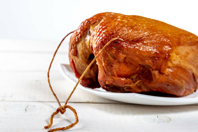Delicious smoked chicken breast on a white background