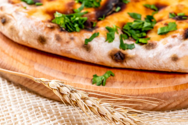 Close-up of khachapuri with greens