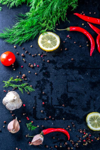 Spices and fresh dill on black background