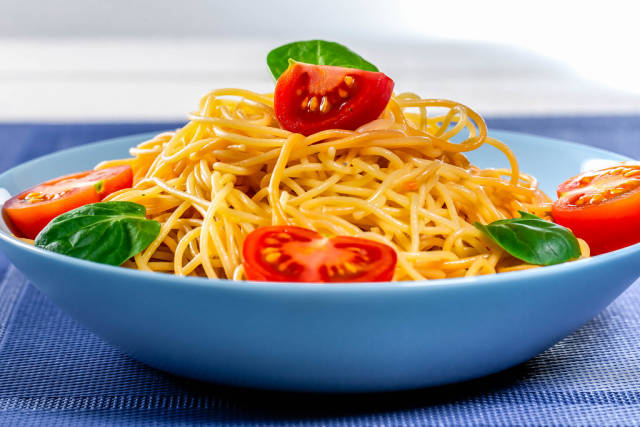 Blue plate filled with spaghetti