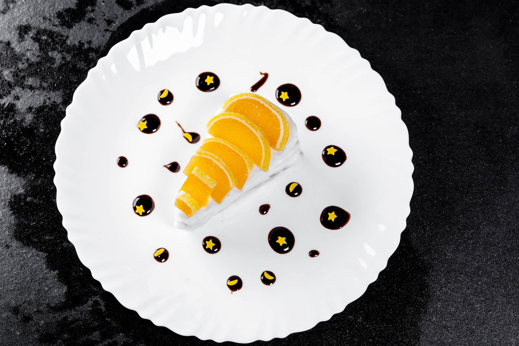 Creamy marmalade dessert on a black background. Top view