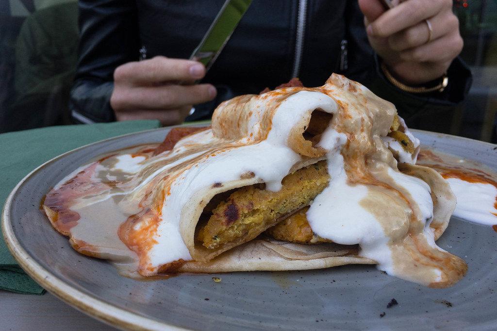 Beyti falafel with yoghurt/tahini sauce and hot pepper/mint oil