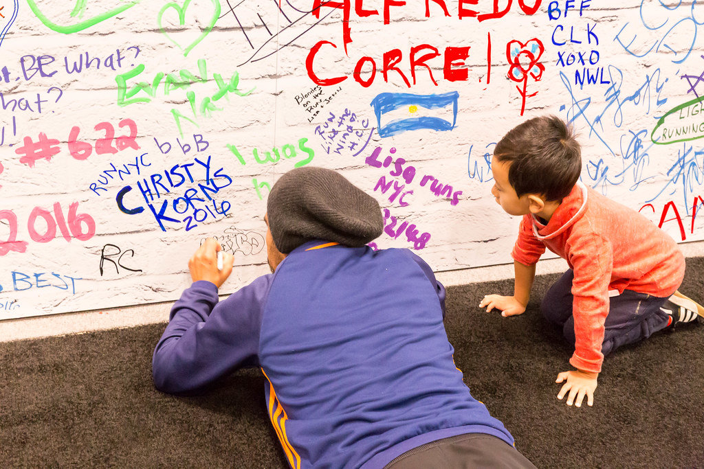 Father and Son signing wall at Marathon Expo New York
