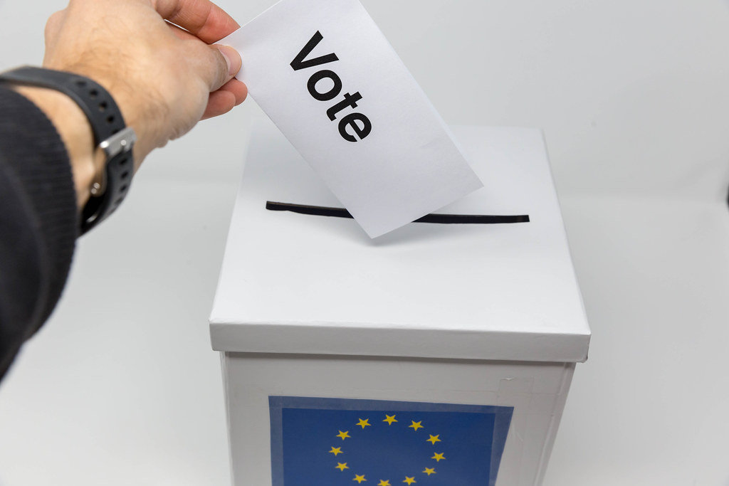 Man exercises his right to vote and holds a voting paper for the European elections
