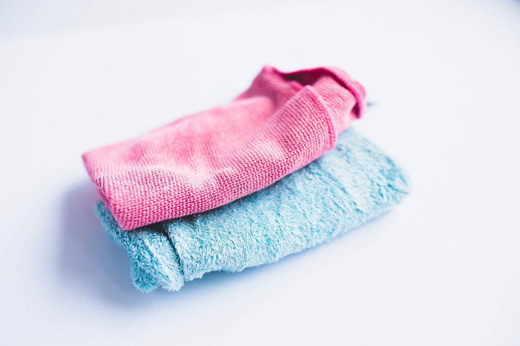 Two microfible cloths on white background