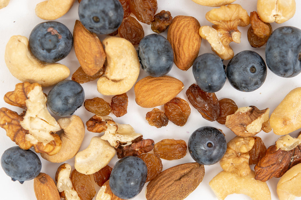 Flat lay above Crispbreads Blueberries Almonds Raisins and other