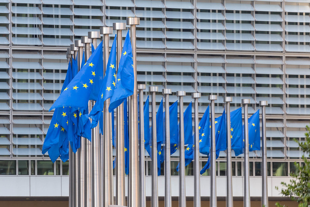 Flags of the European Union in front of the Berlaymont Building in Brussels, Belgium