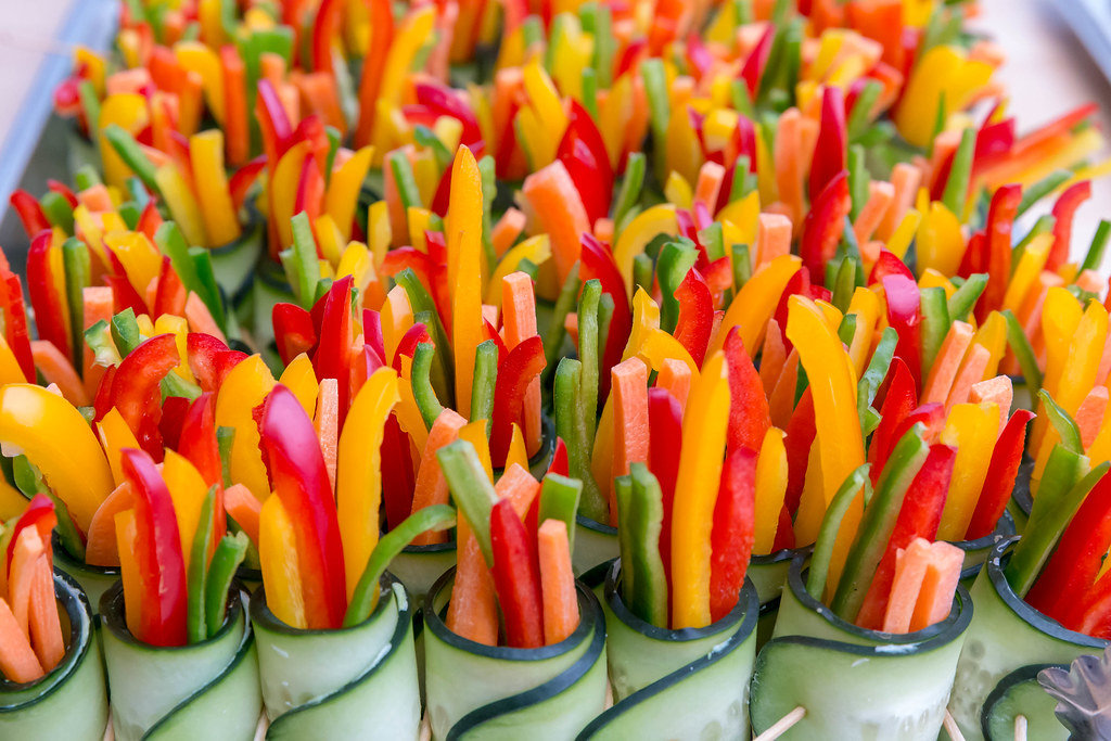 Colorful pepper slices rolled up in cucumber slices