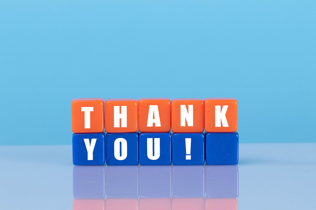 Thank you! text with orange and blue cubes