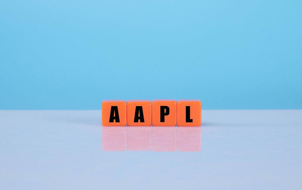 AAPL text on orange cubes