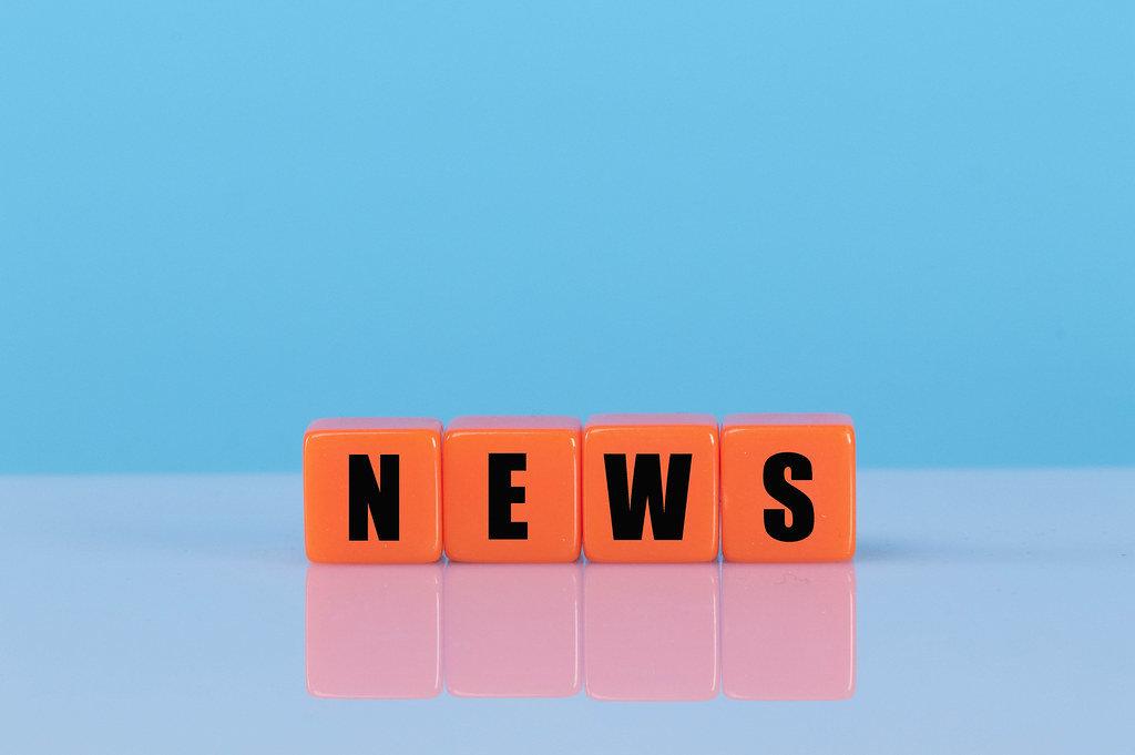 News text on orange cubes