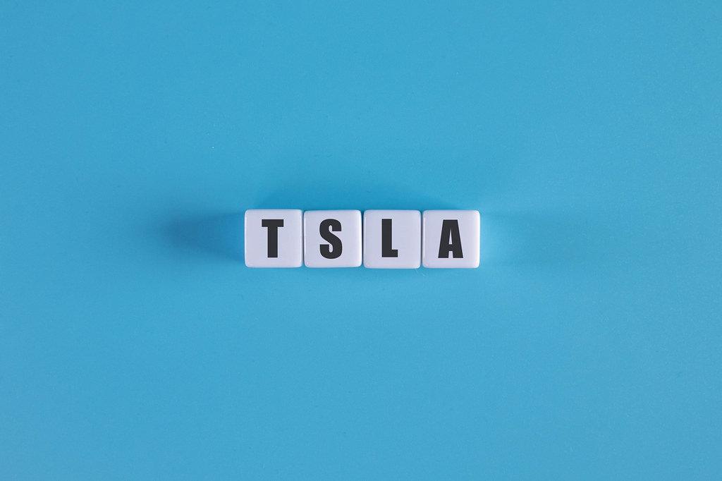 TSLA text on white cubes