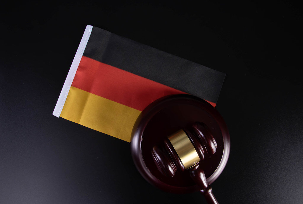 Wooden judge gavel with flag of Germany