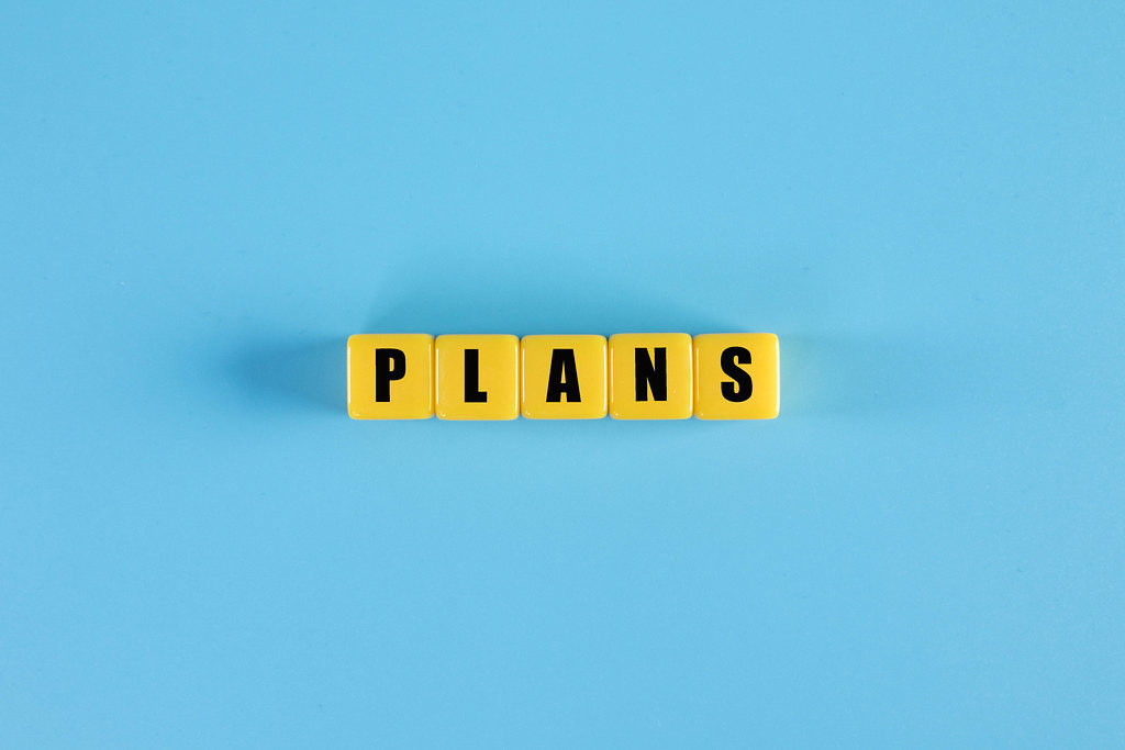 Plans text on yellow cubes