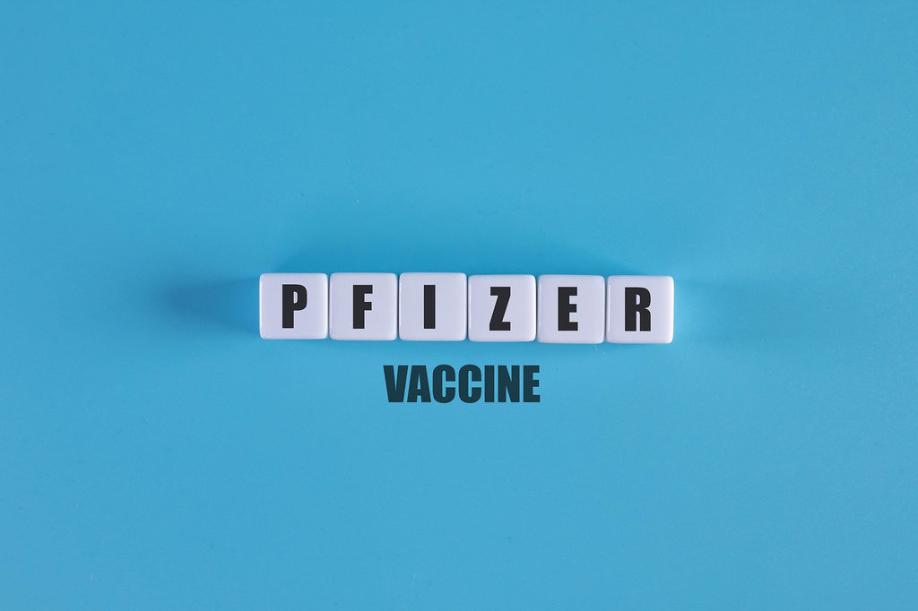 Pfizer vaccine text with white cubes