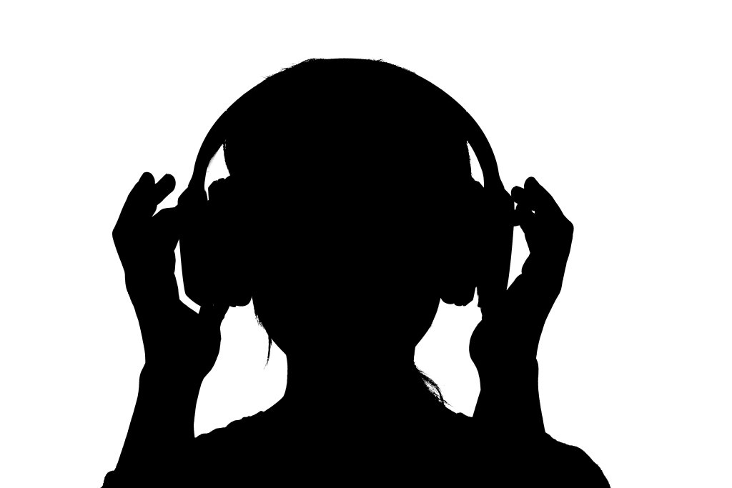 A female silhouette with wireless headphones set