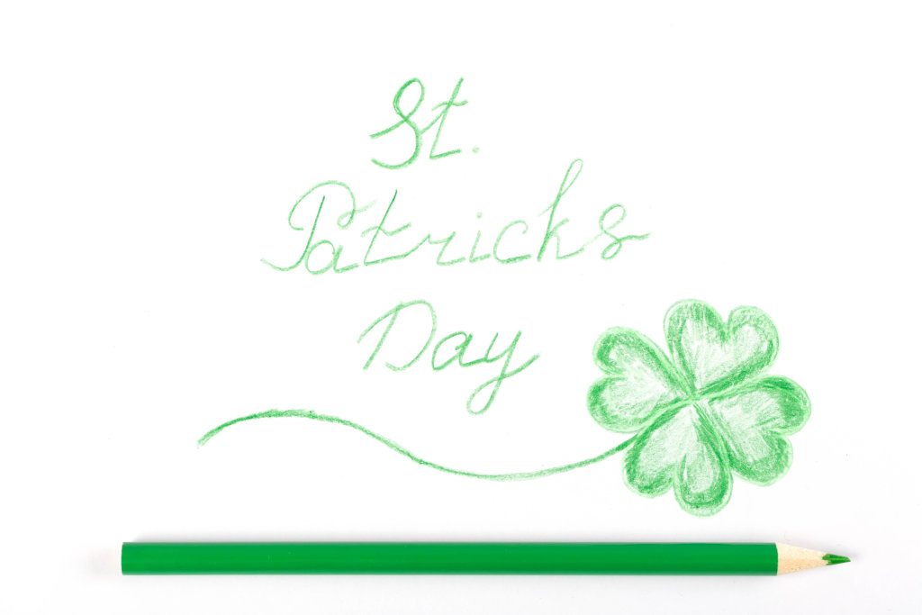 Drawn st patricks day greeting on white with green pencil