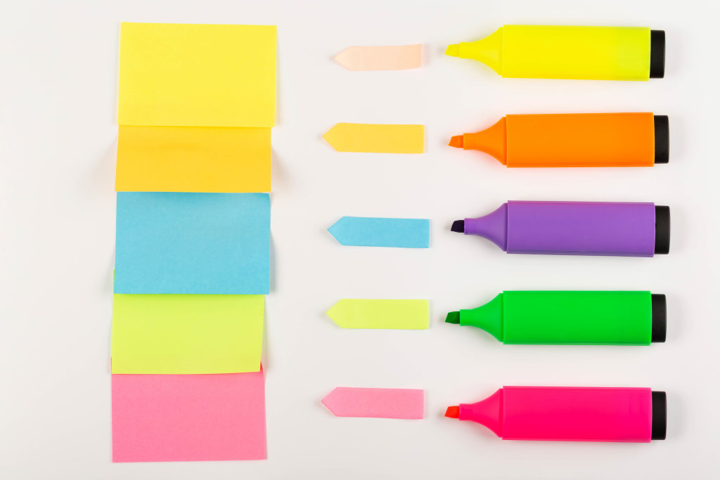 Colored open markers with multicolored paper stickers, concept for notes, plans