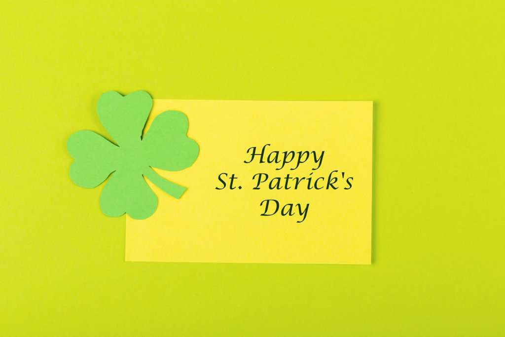 Happy st patricks day concept on green background