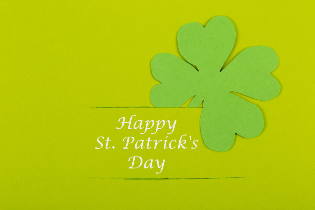 Clover leaf on green background, happy patricks day wish