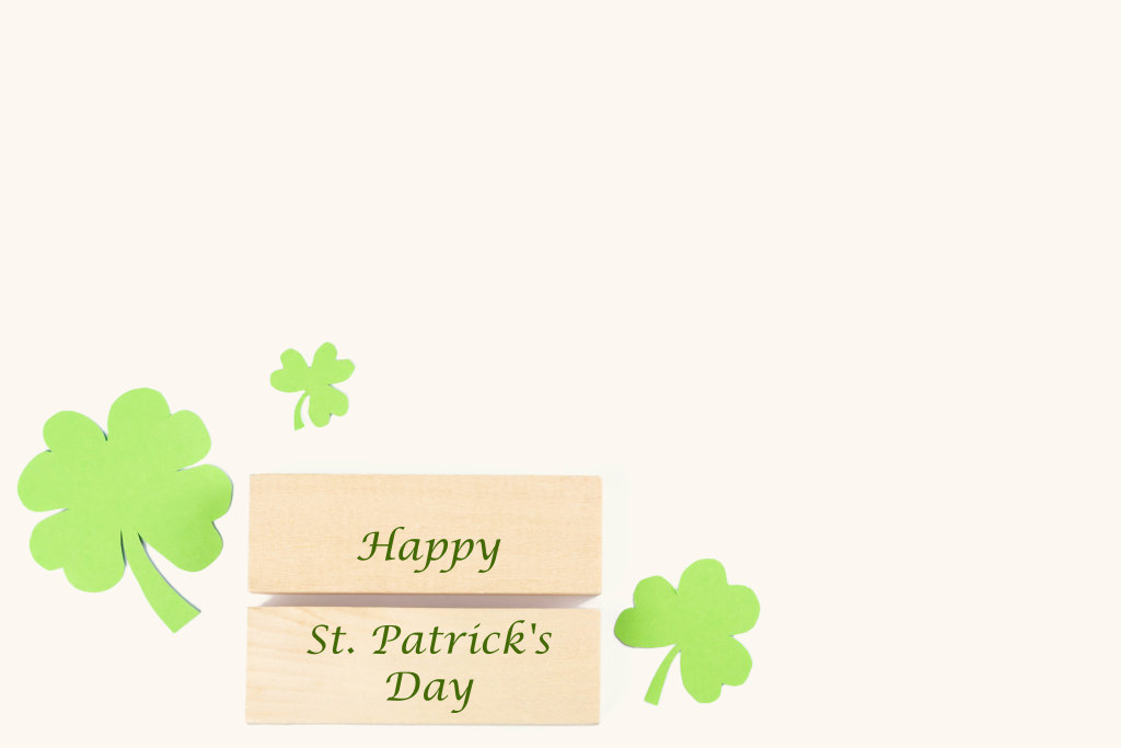Happy st patricks day wooden blocks with paper clover leaves