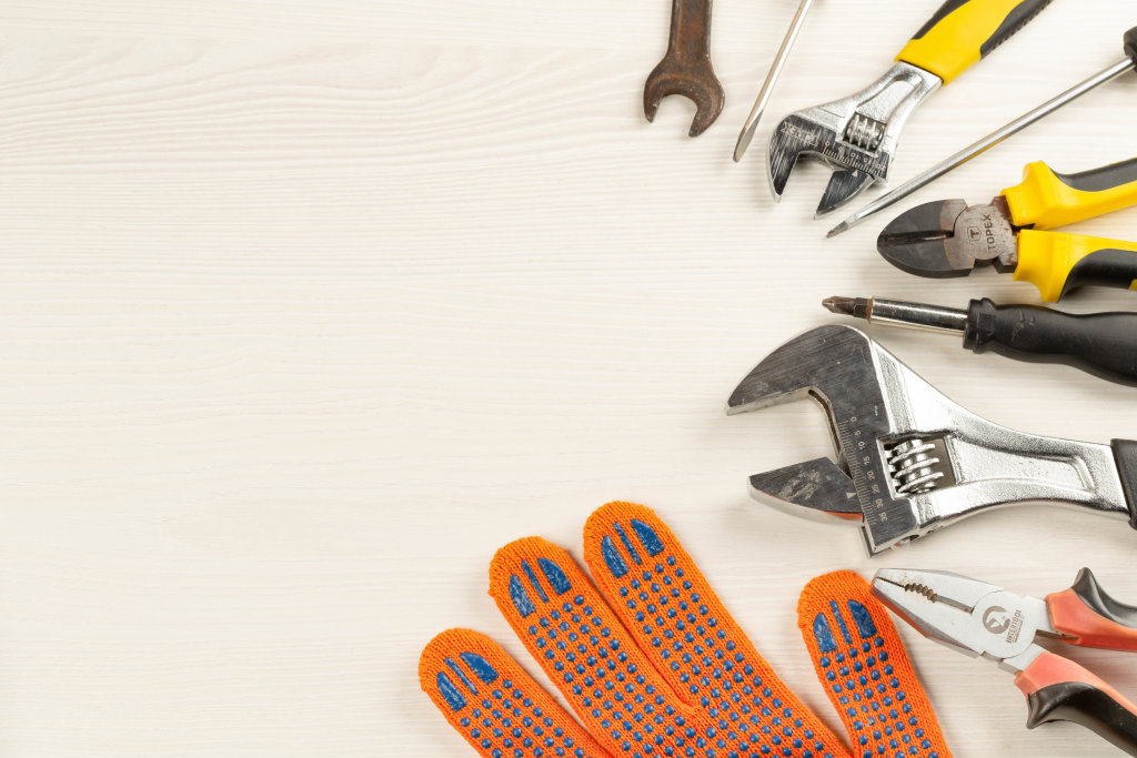Hand working tools on wooden background with free space