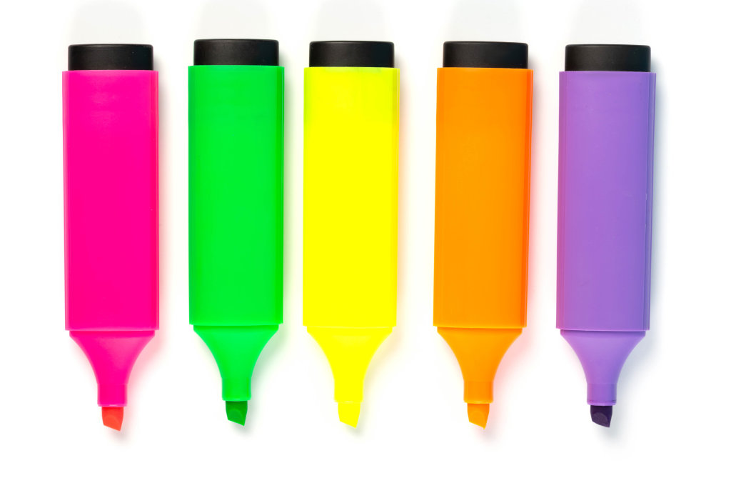 Open colored markers on white background