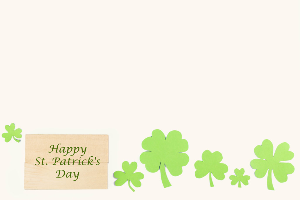Patricks day greeting message with clover leaves