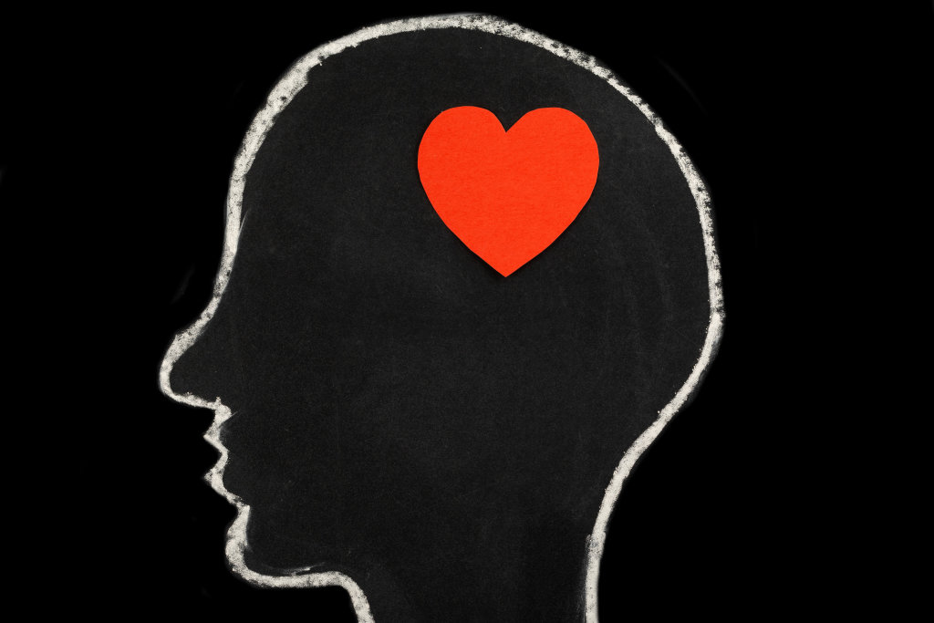 Paper red heart in mans head, concept love