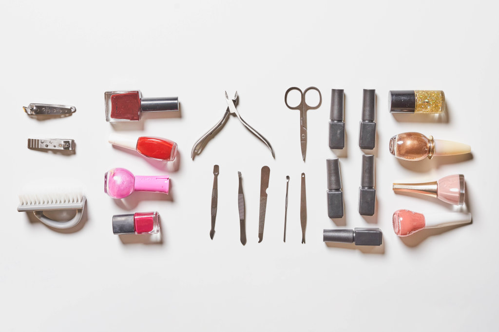 Stylish trendy manicure accessories with gel nail polishes, scissors, cuticle pusher and other tools