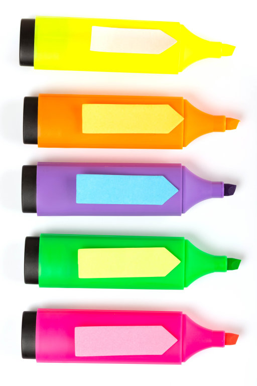 Colorful post-it notes in the form of arrows on markers