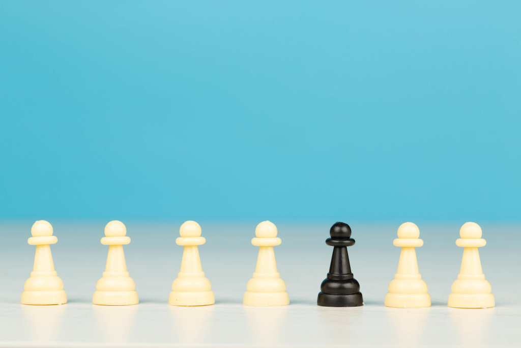 Concept be different, one in crowd, one black pawn with lot of white pawns