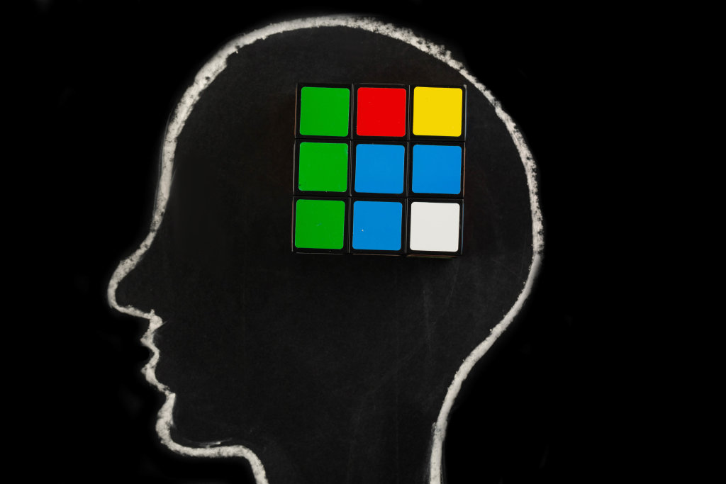 Silhouette of human head with rubiks cube, concept of mind, thinking and ideas