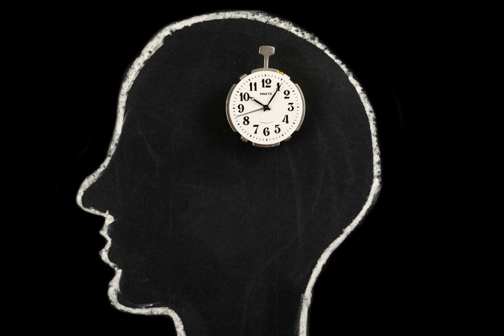 Human head silhouette with clock