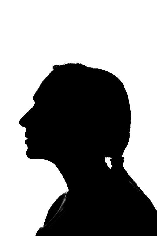 Isolated silhouette of a young woman against the white background