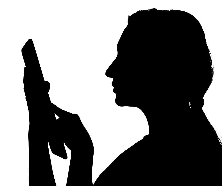 Shadow of a woman using a tablet