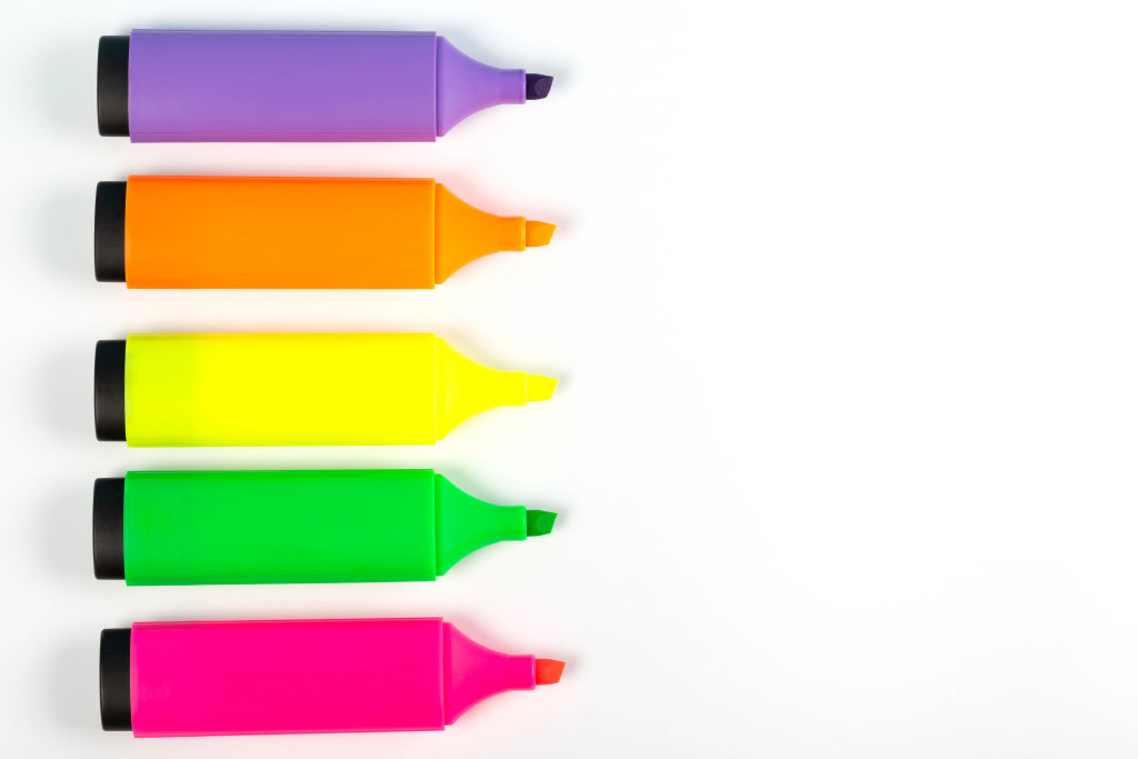 Multicolored markers on white background with free space, top view