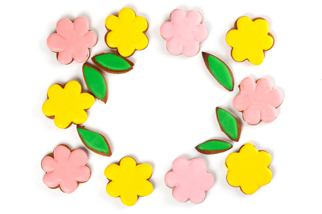 Top view, frame of yellow and pink gingerbread flowers