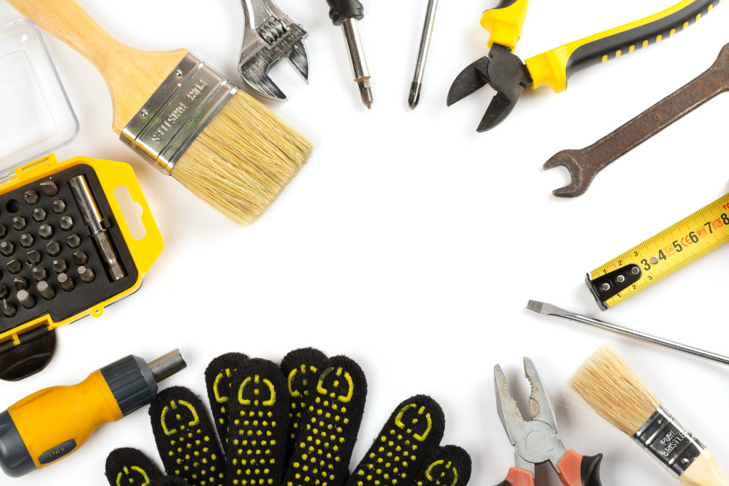 Top view, frame of work tools and gloves on a wooden background