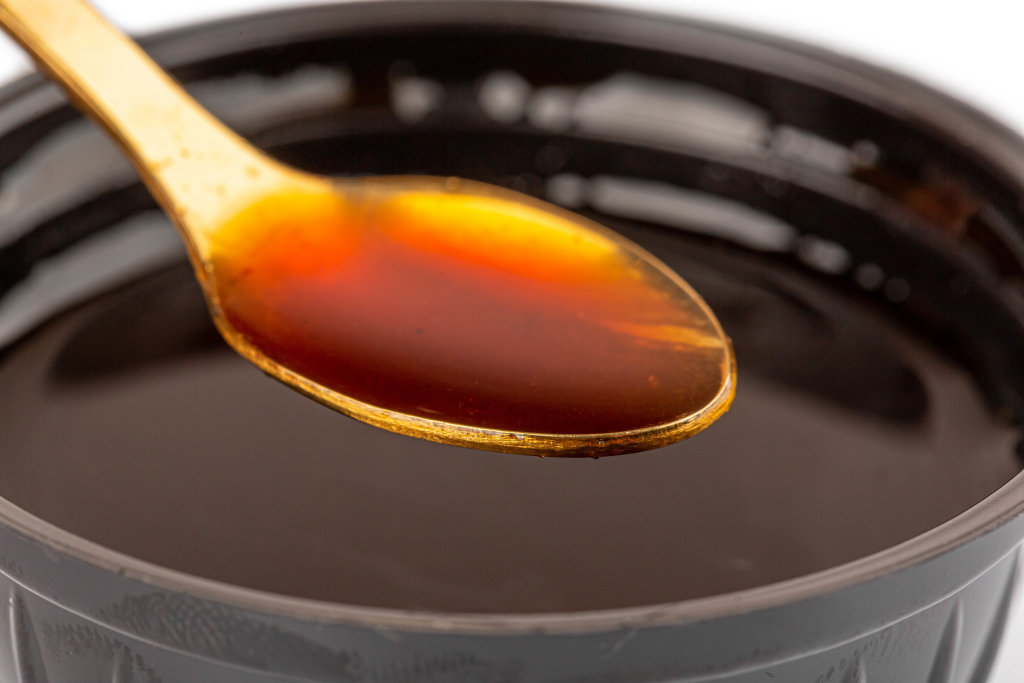 Barbecue sauce in a spoon close-up