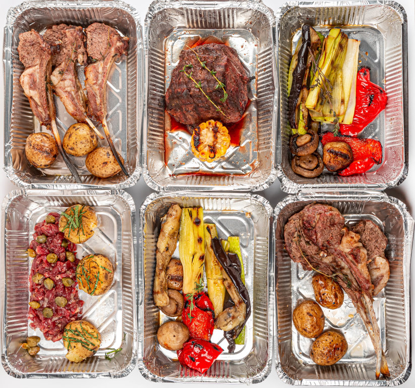 Assortment of delicious food in containers, top view