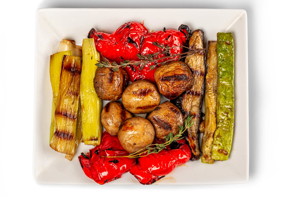 Grilled vegetables mix on plate, top view