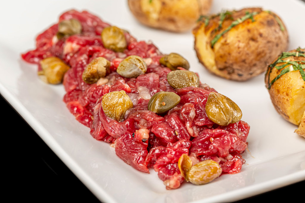 Close up of beef tartar with capers