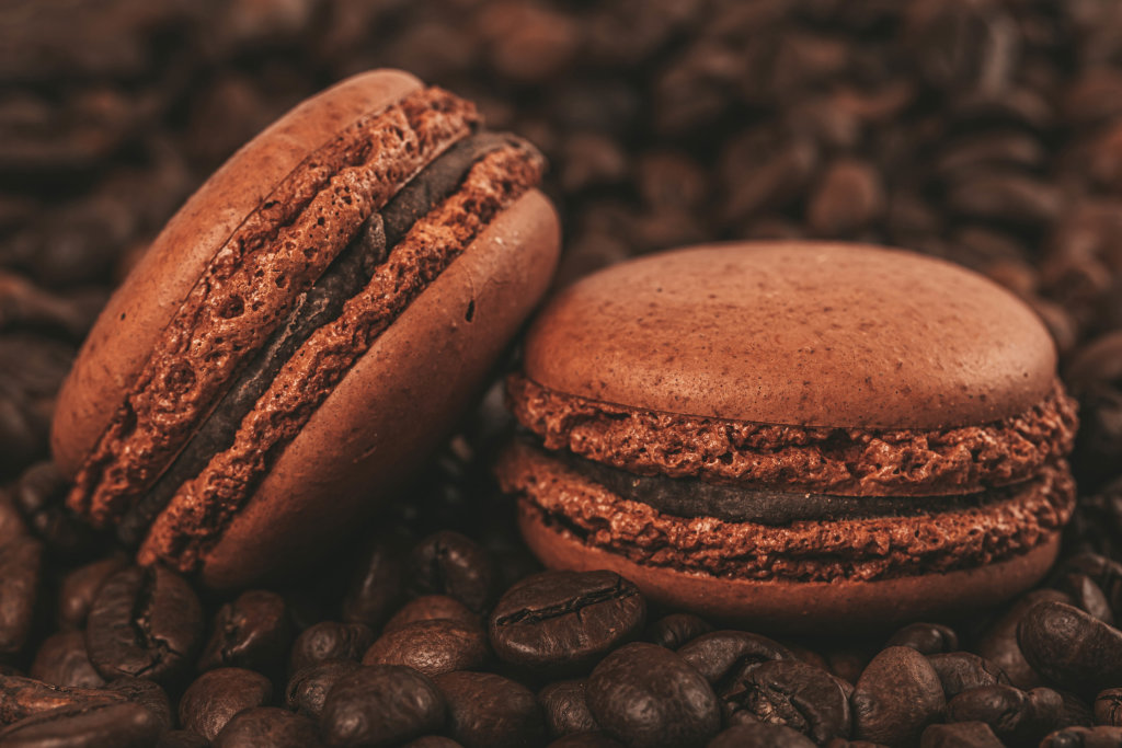 Chocolate macaroons and coffee beans, close-up